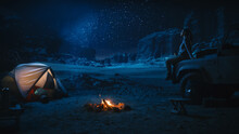 Female Traveler Sitting On Her SUV Hood Watching Night Sky While Camping In The Canyon By Campfire. Wanderlust Woman Adventurer On Inspirational Nature Loving Journey Looking At Milky Way Stars