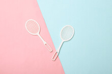 Doll Tennis Rackets On A Blue-pink Pastel Background. Top View