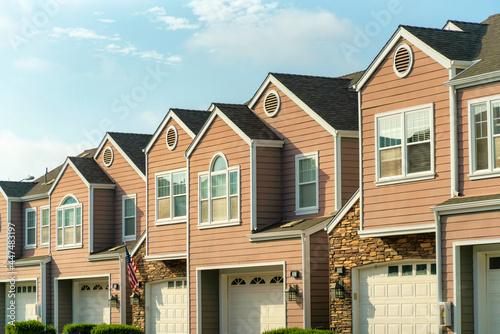 Obraz na plátně Apartment building with garages