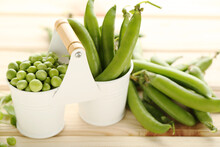 Fresh Peas In Buckets On Brown Wooden Table