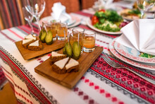 Salted Pork Fatback With Rye Bread, Pickles And Medovukha On Table