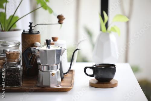 Obraz na plátně Aluminium moka pot and black coffee cup with coffee stuffs