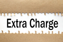 Extra Charge, Text On Torn Paper. Test In Black Letters