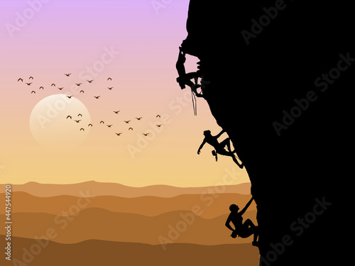 Foto Silhouette of three mountain climbers climbing with sunset in the background