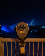 Night Time City Scape Behind Binoculars At Niagara Falls