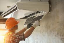 Air Conditioner Repairmen Work On Home Unit