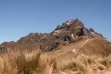 Rocky Mountain Peak Blue Sky And Grassy Landscape At Rucu Pichincha