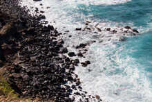 Beautiful View From High Up On The Norther Shores Of Maui, Overlooking The Waves Rolling In From The Pacific Ocean And Crashing Over The Black Rock Coastal Beach.