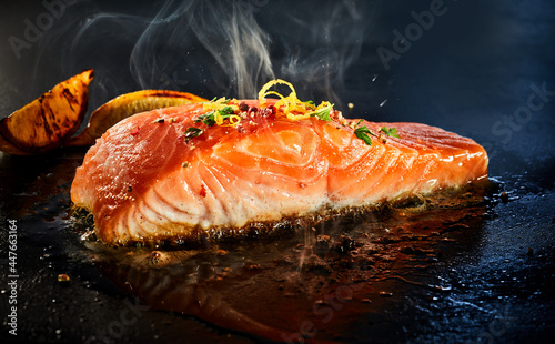 Fotografie, Obraz Gourmet portion of thick juicy salmon grilling on a griddle
