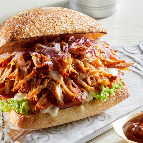 Burger with pulled pork on table
