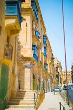 Colorful Wooden Traditional Maltese Balconies. Traditional Maltese Doors And Windows In Malta. Bow Windows Inspired By The The Mashrabiya Of Arab Countries, MDINA
