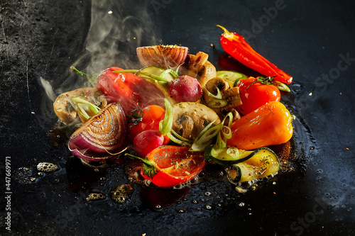 Appetizing various vegetables cooking on black surface
