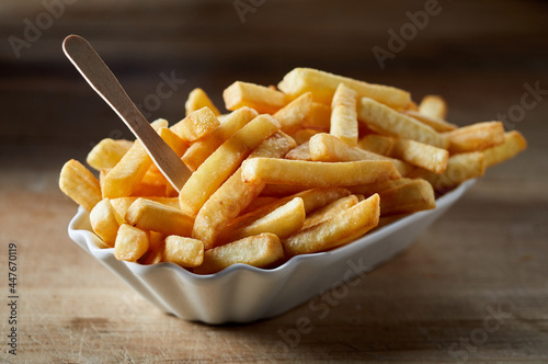 Tasty French fries with eco stick in ceramic bowl
