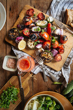 Grilled Vegetables Including Red Tomatoes And Pepper With Sliced Eggplants And Onion
