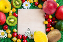 Fresh Fruit On A Brown Background With  Paper