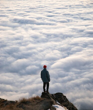 Travel Lifestyle View Of Man On Mountain Hike Above Cloud Inversion On Roys Peak, Near Wanaka, South Island Of New Zealand.