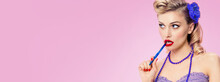 Image Of Beautiful Woman With Pen, In Pin Up Style Clothing, On Pink Colour Background. Caucasian Blond Girl Posing In Retro Fashion And Vintage Studio Concept. Wide.