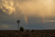 Karoo Windmill And Dirt Road At Sunset After Thunderstorm, N12 Highway, Rural South Africa.