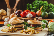 Tasty Hamburgers Served With French Fries On Table