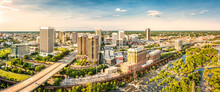 Aerial Panorama Of Richmond, Virginia, At Sunset. Richmond Is The Capital City Of The Commonwealth Of Virginia. Manchester Bridge Spans James River