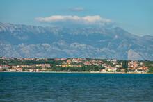 Seafront Vacation Houses Sprawl Along The Coast Beneath Velebit Mountain Range