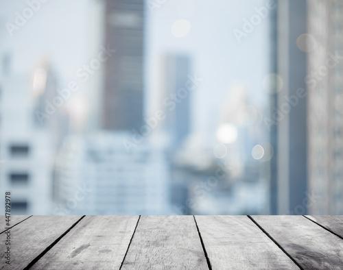 Fototapeta Panoramic empty grunge wood counter table top on blur glass window white light c