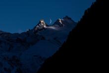 Mountain Peaks Against Evening Sky