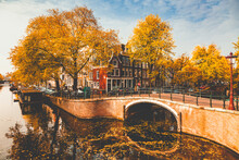 Postcard Picture Of Beautiful Canals And Traditional Dutch Buildings In Amsterdam, The Netherlands