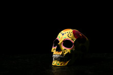 Painted Human Skull For Mexico's Day Of The Dead (El Dia De Muertos) On Dark Background