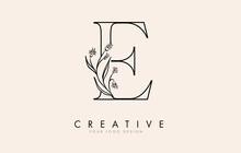 Black Outline E Letter Logo Design With Black Flowers Vector Illustration.