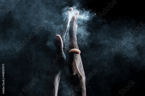 Fotografía African man hands interacting with with flour or powder.