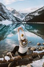 Unrecognizable Woman Traveler Sitting Near Calm Lake