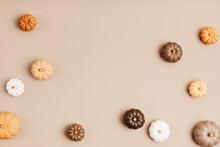 Composition Of Handmade Plaster Pumpkins. Autumn Seasonal Holidays Background In Natural Colors. DIY Craft Gypsum Pumpkins For Helloween, Thanksgiving, Fall Decoration
