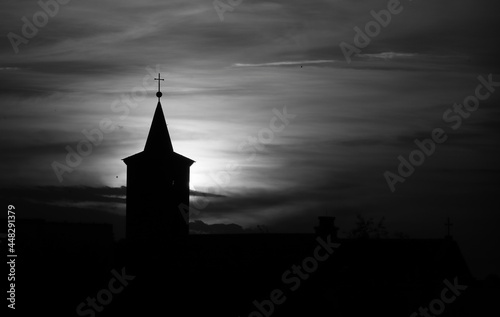 The belfry and the cross on the dome of the church at sunset Fotobehang