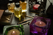 High Angle Shot Of A Decorative Candle And Essential Oil In Small Jars With Matches On The Table
