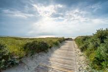 Wooden Boardwalk Near The Beach
