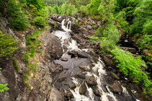 The Rogie Falls, A Series Of Waterfalls Near The Village Of Contin, Ross-Shire, Scotland, UK, Viewed Here From The Suspension Bridge.