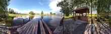 Wooden Bridge Over The Lake