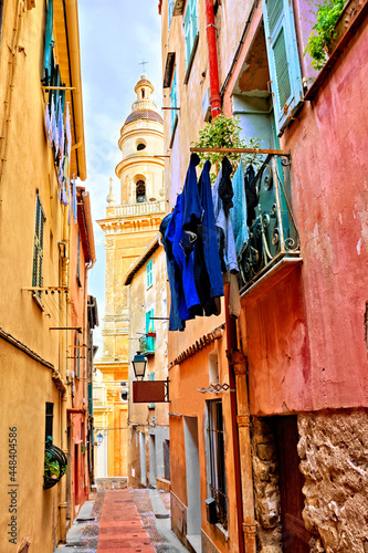 Obraz na plátně Colorful street in the French Riviera town of Menton with basilica bell tower