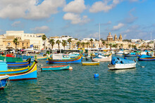 Traditional Luzzu Fishing Boats Moored At Marsaxlokk Harbor, Malta