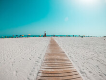Pov And First View Of Person Walking In A White Beach Looking To The Blue Sea Or Ocean In A Sunny Day Of Vacation