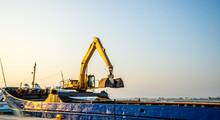Long Armed Digger On A Coastal Barge