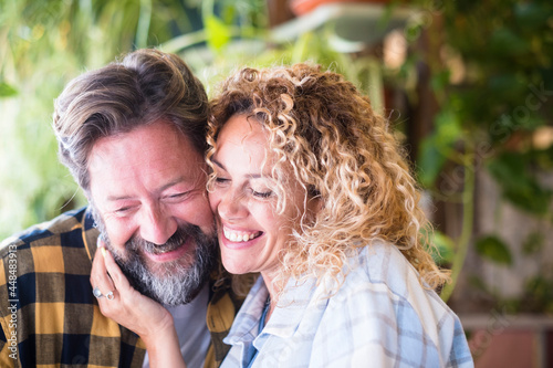 Fototapeta Happy and cheerful adult caucasian couple portrait smile and enjoy love and rela