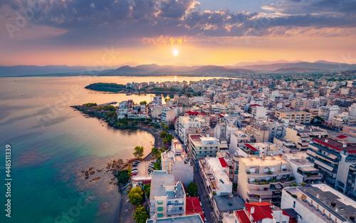 Spectacular sunrise in Chalcis town, Greece. Splendid summer seascape of Aegean sea, North Euboean Gulf. Incredible morning scene of Euboea island, Greece, Europe.