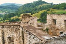 Exterior Of Medieval Castle In Novigrad Na Dobri, Croatia, And Old Stone Bridge