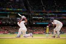 Cricketer Batsman Hitting A Shot During A Match On The Cricket Pitch During A Match