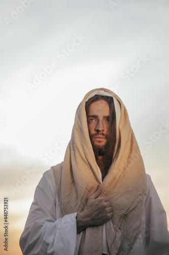 Fotografie, Obraz Portrait of Jesus Christ in white robe against sky.