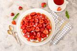 Fototapeta Kawa jest smaczna - Composition with tasty strawberry pie on light background