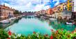 canvas print picture - Peschiera del Garda - charming village with colorful houses in beautiful lake Lago di Garda. Verona province, northern Italy