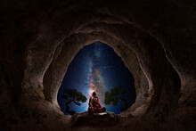 Buddhist Monk Meditation From A Natural Cave